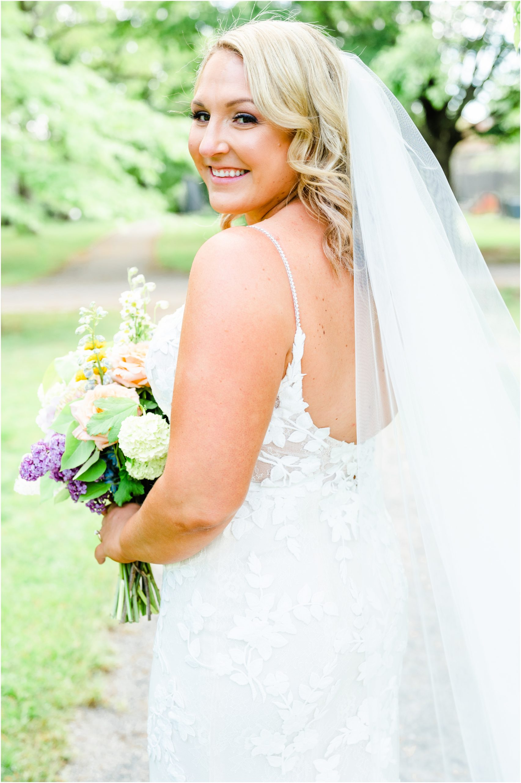 bridal portrait with veil in park by MA wedding photographer